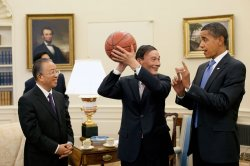 President Obama gives a basketball to Chinese Vice Premier Wang Qishan in the Oval Office