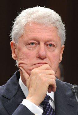 Bill Clinton and Bill Gates testify on Capitol Hill in Washington