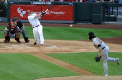 Bloomquist drives the ball during Opening Day in Arizona