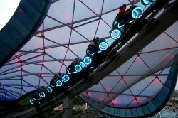 Chinese hit high speeds on the Tron roller coster in Shanghai Disneyland, China