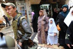 Palestinians walk in Jerusalem on Ramadan