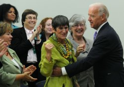 Vice President Joe Biden hugs Rep. Rosa Delauro (D-CT) in Washington