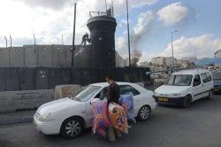 Palestinian Vendor Near Israeli Separation Wall, West Bank