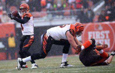 Bengals' Dalton throws a pass behind a block