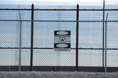 Warning Sign Hangs on the El Paso, Texas Border Fence