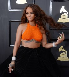 Rihanna arrives for the 59th annual Grammy Awards in Los Angeles