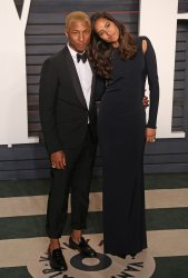Pharrell Williams and Helen Lasichanh arrive at the Vanity Fair Oscar Party in Beverly Hills