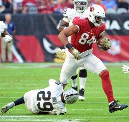 Cardinals' Gresham tries to break a tackle