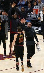 Cleveland Cavaliers Kyle Korver is greeted by Kevin Love after hitting a three point shot against the Chicago Bulls