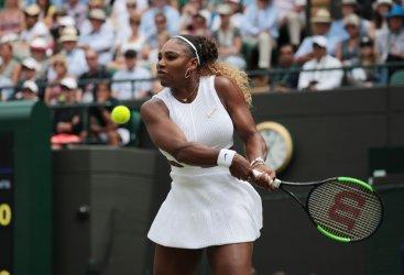 Serena Williams returns in her fourth round match against Suarez Navarro at Wimbledon