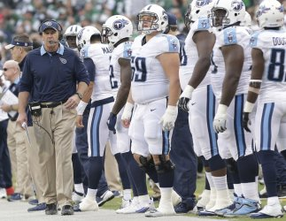 Titans head coach Mike Mularkey stands on the sidelines