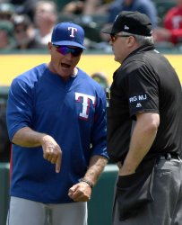 Rangers manager Jeff Banister argues a foul ball call in Oakland