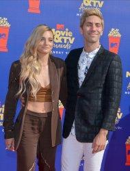 Nev Schulman and Laura Perlongo attend the MTV Movie & TV Awards in Santa Monica, California