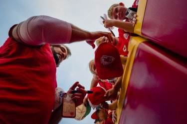 A Chiefs player signs autographs