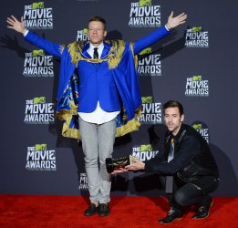 Recording artists Macklemore and Ryan Lewis appear backstage at 2013 MTV Movie Awards in Culver City, California
