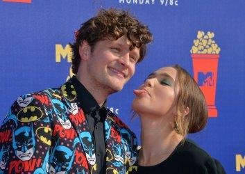 Brett Dier and Haley Lu Richardson attend the MTV Movie & TV Awards in Santa Monica, California