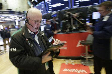 Dow Jones Industrial Average closes above 26,000