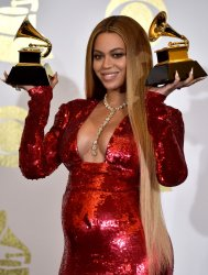 Beyonce wins an award at the 59th annual Grammy Awards in Los Angeles