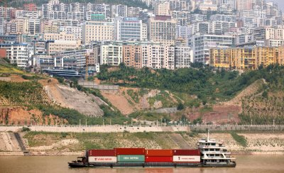A lone Chinese boat dredges the bottom of the Yangtze River