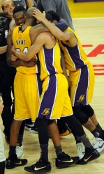 Los Angeles Lakers Kobe Bryant is congratulated in the final moments of his last game
