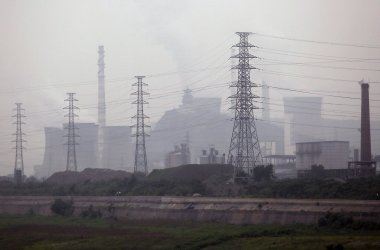 A heavy fog blankets a major coal-powered energy plant in Beijing