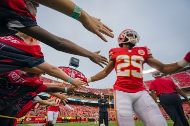 Chiefs Kendall Fuller slaps hands with fans
