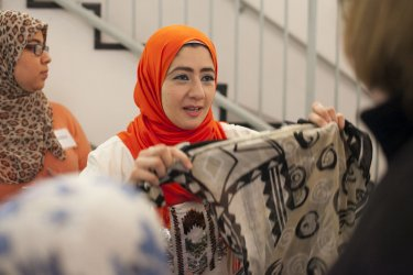 Visitors try on Hijab during Meet a Muslim event in Massachusetts