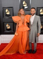 Chrissy Teigen and John Legend arrive for the 62nd annual Grammy Awards in Los Angeles