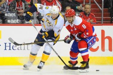 Mattias Ekholm and Alex Ovechkin Fight for Lose Puck