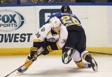 St. Louis Blues Paul Stastny and Nashville Predators Viktor Arvidsson collide