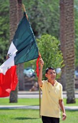 Man carries Mexican flag after Supreme Court's decision on SB1070 in Arizona