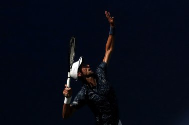 Novak Djokovic of Serbia serves at the US Open