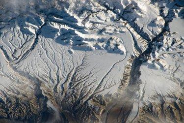 The Himalaya range, near the ChinaÐIndia border -- where peaks cast strong evening shadows on the snow
