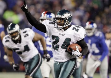 Philadelphia Eagles Sheldon Brown reacts while running a New York Giants fumble back 60 yards for a touchdown at Giants Stadium