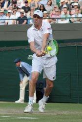 Sam Querrey returns the ball in his Quarter-Final match against Rafael Nadal at Wimbledon