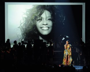 Monica performs a tribute to Whitney Houston during BET Awards 12 in Los Angeles