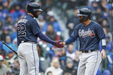 Braves Kurt Suzuki celebrates after scoring against Cubs in Chicago