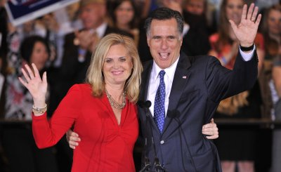 Romney and Wife Wave to Supporters at Election Night Party in Schaumburg, Illinois