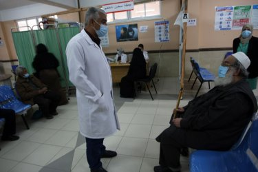 Palestinians Receives a Dose of COVID-19 in Gaza.