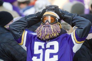A dejected fan sits in disbelief of Vikings loss to the Seattle Seahawks
