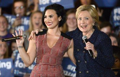 Hillary Clinton attends campaign event with singer Demi Lovato in Iowa City, Iowa