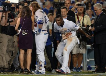 Dodgers Puig celebrates with teammate Turner in win over Cubs in the NLCS game two