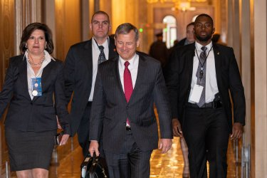 Chief Justice of the United States John G. Roberts walks into Capitol Hill