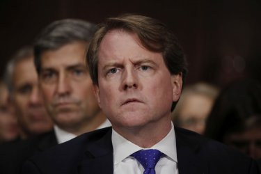 White House coounsel Don Mcgahn listens to U.S. Supreme Court nominee Kavanaugh testify at his Senate Judiciary Committee confirmation hearing on Capitol Hill in Washington