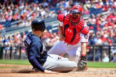 Nationals catcher Jamie Burke tags out Braves' Freddie Freeman