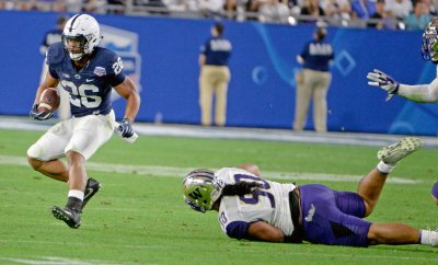 Penn States' Barkley avoids a tackle