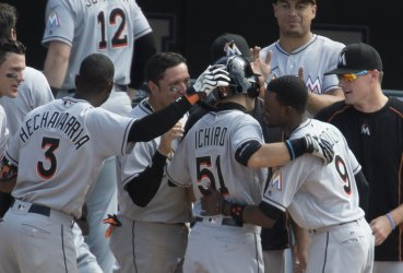 Miami's Ichiro records 3,000th MLB career hit at Coors Field in Denver