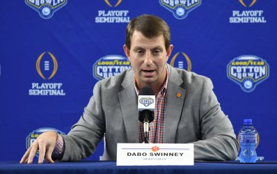 Clemson head coach Dabo Swinney answers a question at Media Day