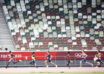 Athletes race past empty seats in Men's 800m semifinal at Summer Olympics in Tokyo, Japan