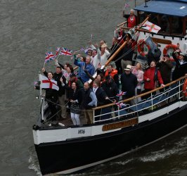 Riverboats sail down the River Thames for Royal Diamond Jubilee Pageant in London